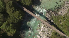 AERIAL: Raging emerald river and whitewater rapids running in rocky riverbed Stock Footage
