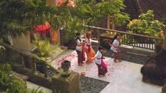 Balinese women teaching tourist dancing on balcony in jungle, long shot Stock Footage