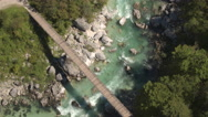 AERIAL: Fast green river and whitewater rapids running in rocky riverbed Stock Footage