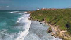 Aerial view of cliff shore in south Bali, moving backwards Stock Footage