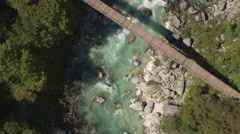 AERIAL: Raging green river and whitewater rapids running in rocky riverbed Stock Footage