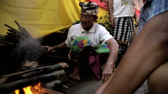 Bali - Balinese outdoor male making open fire for cooking  Stock Footage