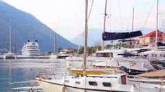Luxury yachts and boat docked in the sea marina Stock Footage