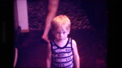 1974: cute kids at dining room table kitchen for breakfast FORT WAYNE, INDIANA Stock Footage