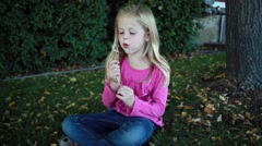 Young Child with Dandilion, makes a wish HD  Stock Footage