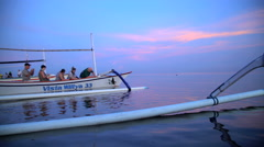 Bali - Balinese catamaran craft with tourists  Stock Footage