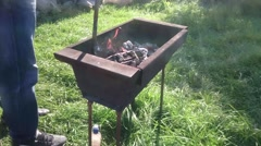 Grill on charcoal, Frying Fresh Meat, Man working at BBQ at Picnic. Timelapse. Stock Footage