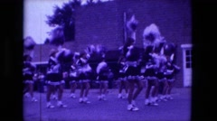 1974: high school cheerleaders participate in parade FORT WAYNE, INDIANA Stock Footage