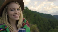 Happy Young Woman Sips From An Enamel Mug, Enjoys Sunset In The Mountains Stock Footage