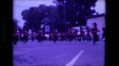 1974: marching band parade red jackets drums horns flutes FORT WAYNE, INDIANA Stock Footage