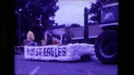 1974: parade float being pulled through the street by tractor FORT WAYNE Stock Footage