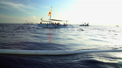 Bali - View of Dolphins swimming near traditional Outrigger  Stock Footage
