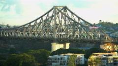 Traffic on steel construction of commuter landmark Story Bridge in Queensland Stock Footage