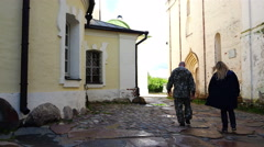 Tourists walk through the historic area of ancient buildings Cyril Belozersky Stock Footage