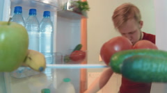 Young man opens the fridge takes bottle of water and drinks Stock Footage