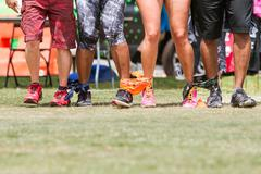 Young Adult Legs Walk In Unison At Five-Legged Race Stock Photos