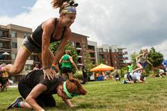 Women Play Leap Frog In Atlanta Field Day Event Stock Photos