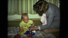 1974: mother with small child is seen FORT WAYNE, INDIANA Stock Footage