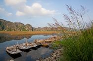 Landscape with boat, mountains and clouds Van Long Natural Reserve (Ninh Binh Stock Photos