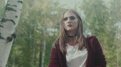 Beautiful girl in the forest. Portrait of a model with bright makeup Stock Footage