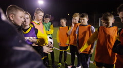March 2016. British youth soccer team training huddle for a team talk Stock Footage