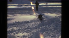 1978: dog trying to walk in the snow with boy LAS VEGAS Stock Footage