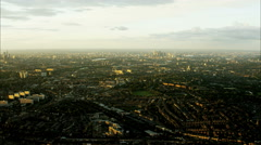 Aerial view at sunset of London UK suburbs and city skyscrapers Stock Footage