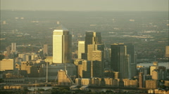 Sunset aerial view of London buildings and skyscrapers in Canary Wharf UK Stock Footage