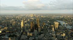 Aerial sunset view of bridges over the River Thames and skyscrapers in London UK Stock Footage