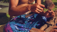 Balinese man carving a wooden statuette, close up Stock Footage