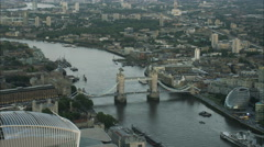 Aerial view at night of Tower Bridge over River Thames London UK Stock Footage