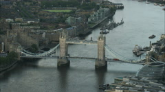 Aerial view of The Shard building and Tower Bridge in metropolitan London UK Stock Footage