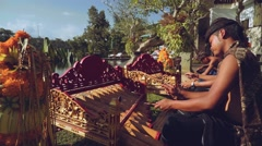 Balinese men playing on gamelan rindik in tradtional clothes Stock Footage