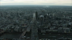 Aerial view at sunset of landmark buildings by the River Thames London UK Stock Footage
