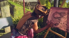 Balinese artist painting in traditional clothes, slider Stock Footage