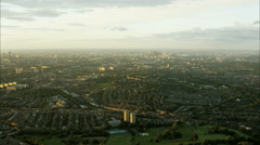 Aerial sunset view of urban residential suburbs and cityscape of London UK Arkistovideo