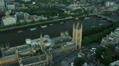 Aerial sunset view of the River Thames and Houses of Parliament London UK Stock Footage