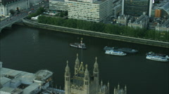 Aerial sunset view of Big Ben and traffic on bridges over River Thames London UK Stock Footage