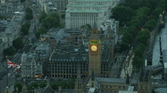 Aerial sunset view of Big Ben and Houses of Parliament in Westminster London UK Stock Footage