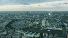 Aerial cityscape view of the London Eye landmark by the River Thames England UK Stock Footage