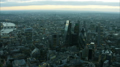 Aerial sunset view of River Thames with the landmark Gherkin Building London UK Stock Footage