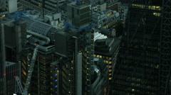 Aerial night view of landmark skyscrapers in the metropolitan city of London UK Arkistovideo