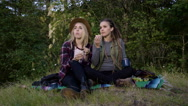 Young Women Eat A Picnic, They Look Off Into The Distance, Enjoy The View Stock Footage