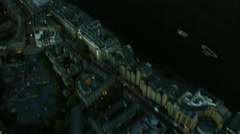 Aerial reveal night view of illuminated buildings and the River Thames London UK Stock Footage