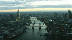 Aerial distant sunset view of the River Thames and city skyline of London UK Stock Footage