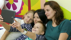 Two Mothers With Their Kids Making Funny Selfie Stock Footage