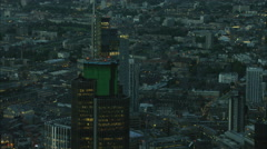 Aerial night view of illuminated skyscraper buildings in the city of London UK Stock Footage
