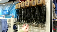 People buying necklace inside Vancouver aquarium gift shop. Stock Footage