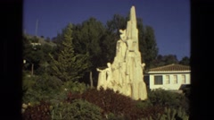 1978: white stone monument climbing statue memorial shining in sunshine FRANCE Stock Footage