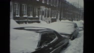 1978: snow storm in the city buries parked vehicles in snow Stock Footage